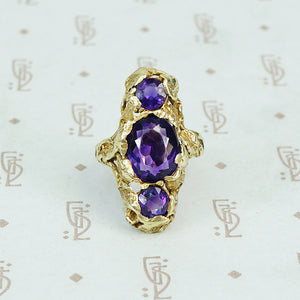 Among the Leaves a Walton and Co Amethyst and Green Gold Ring