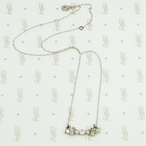 vintage white gold and diamond bow necklace