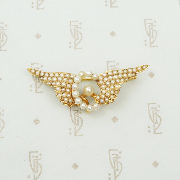 14k yellow gold and pearl chatelaine brooch winged wheel