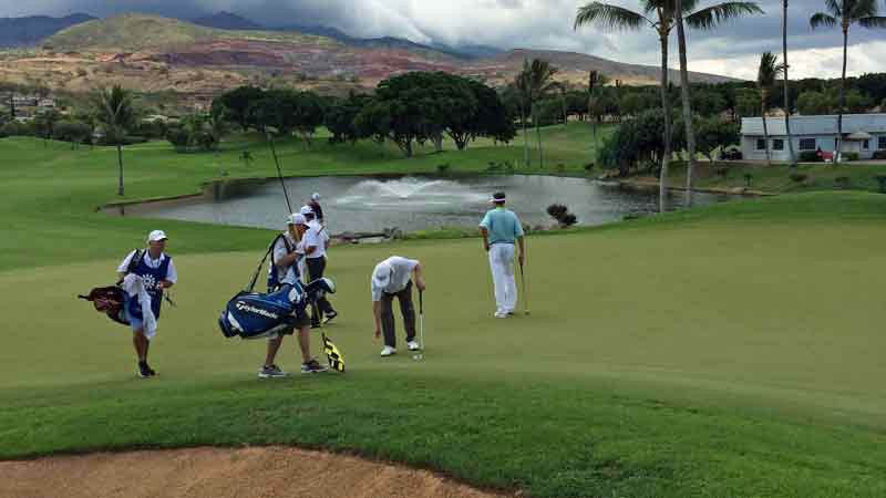 Kapolei  Golf Course and watching Davis Love get ready to putt
