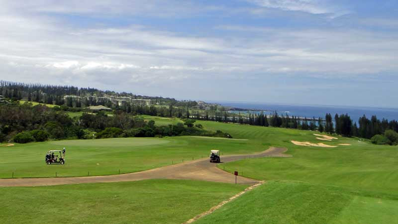 Kapalua Plantation teeing off on hole 1 with 18 green to left