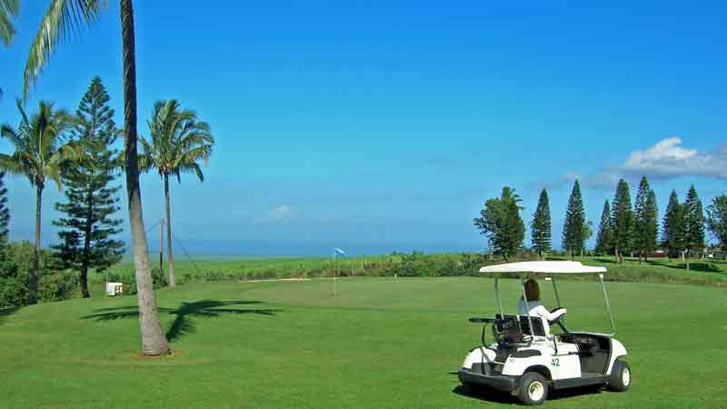 Pukalani Golf Course driving golf cart by second green