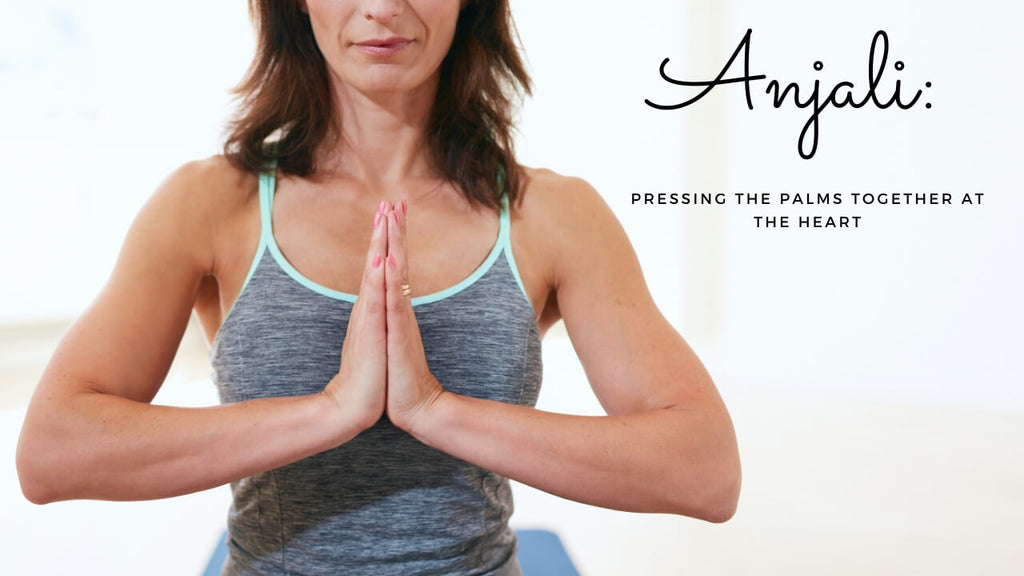 Anjali Yoga Term - Pressing the palms together at the heart.
