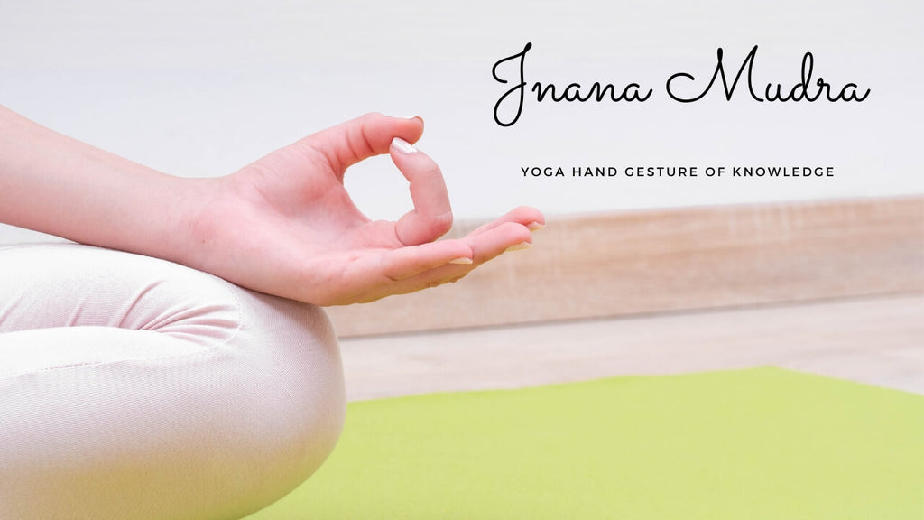 jnana mudra yoga term - Touching the pointer finger and thumb together with the remaining three fingers pulled away.