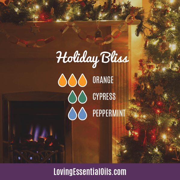 winter essential oil diffuser blends - holiday bliss with orange, cypress, and peppermint
