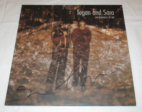 TEGAN AND SARA SIGNED THIS BUSINESS OF ART VINYL RECORD