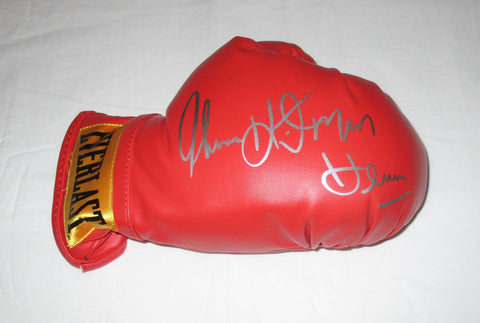 "TOMMY ""HITMAN"" HEARNS SIGNED BOXING GLOVE"