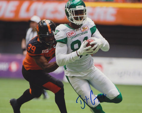 BAKARI GRANT SIGNED SASKATCHEWAN ROUGHRIDERS 8X10 PHOTO