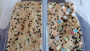 Sensory bins side by side one has numbers in it