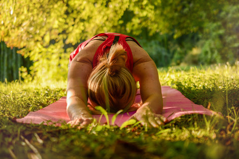 Woman doing a yoga pose self care