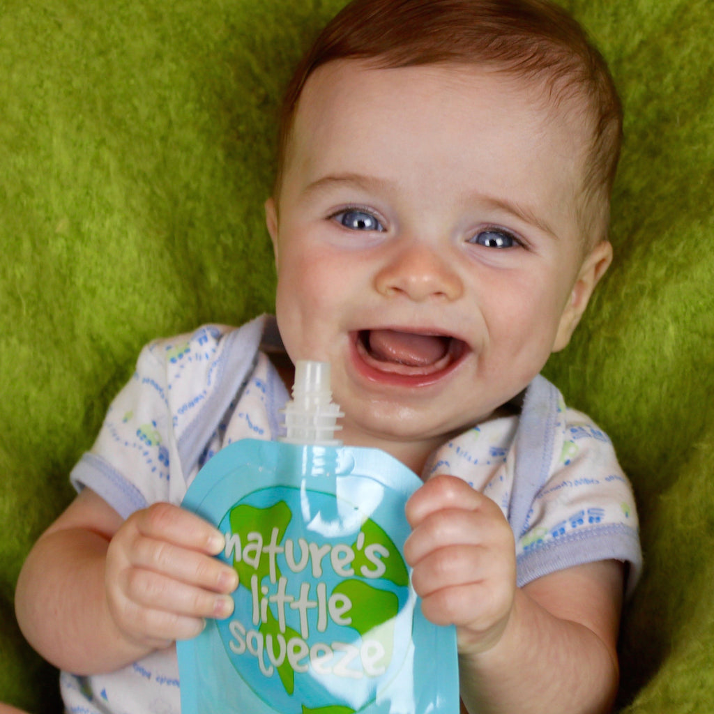 Infant using a Reusable Food pouch