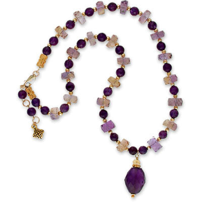 necklace of amatrine rondells and amethyst beads with a large amethyst and citrine pendant