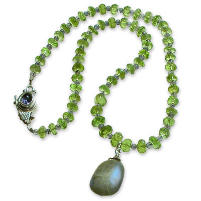 necklace of faceted peridot rondelles and small iolite beads with a large labradorite pendant