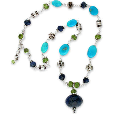 large faceted lapis & peridot pendant on wire-wrapped choker of turquoise nuggets & lapis and peridot rondelles interspersed with sterling silver beads