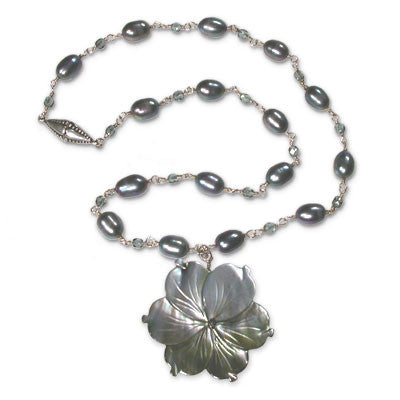 "pale gray mother-of-pearl 'flower' on wirewrapped necklace of large oval peacock pearls & muted-gray austrian crystal. magnetic clasp. pendant drop 2 1/4""."