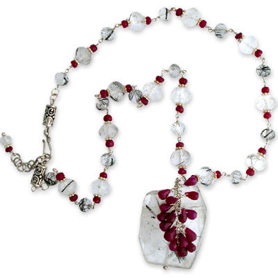 a large flat tourmalinated quartz pendant with ruby briolettes flowing down, on a necklace of extra-fine large & small faceted tourmalinated quartz beads interspersed with small ruby rondelles. adjustable clasp. pendant lengths approx. 1 3/4""