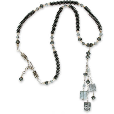 necklace of faceted hematite, faceted aqua beryl beads &amp white silver with a pendant drop of faceted hematite, faceted aqua beryl beads & nearly transparent faceted aqua beryl pillows with schorl inclusions. extendable clasp.