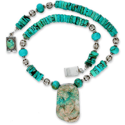 bezel-set pendant of turquoise carved lizard, on chinese heishi, large smooth turquoise beads & sterling silver. bezel-set turquoise & sterling silver clasp.