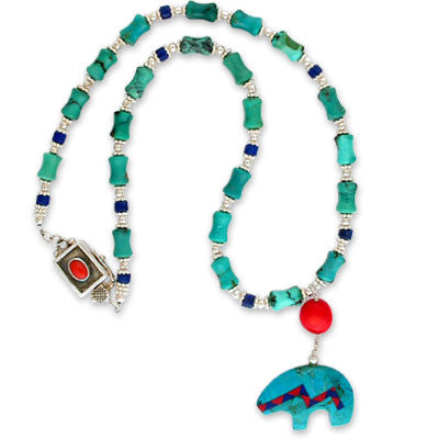 carved turquoise fetish bear with inlaid coral & lapis on turquoise 'bamboo,' lapis heishi & silver. bezel-set coral clasp.