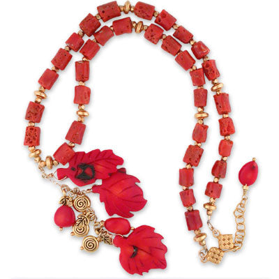 "3"" drop of carved coral leaves & charms on a necklace of sponge coral tubes interspersed with vermeil. expandable clasp."