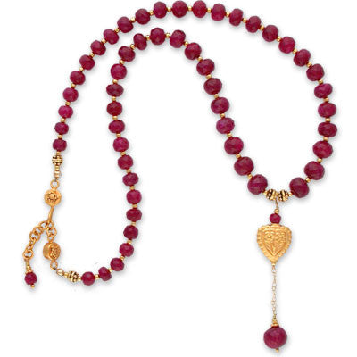 faceted ruby briolette & heart-shaped repousee bead on graduated strand of faceted ruby briolettes. adjustable vermeil clasp.