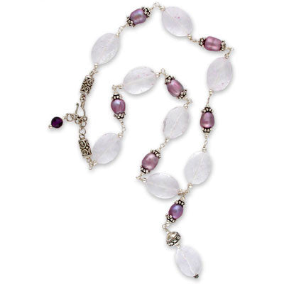 wire-wrapped necklace of faceted <i>cape amethyst</i> pillows & large bead-capped orchid egg pearls with a matching drop.