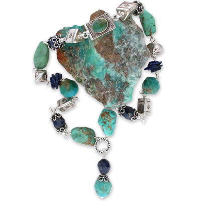 turquoise & lapis drop on a wire-wrapped choker of smooth turquoise nuggets, large roughly faceted turquoise & lapis beads, lapis chips and large sterling silver beads. bezel-set turquoise clasp.