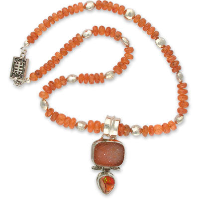 bezel-set pendent of fire agate & apricot drusy on large faceted rondelles of spessartite garnet interspersed with slightly faceted large flat silver beads.