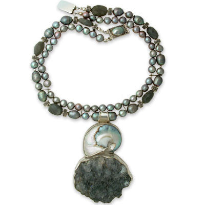 large pendant of bezel-set polished nautilus shell with translucent silvery-gray quartz crystals on two strands of jumbo dark gray egg pearls, 8mm medium gray pearls & silver moonstone. bezel-set mabe pearl clasp.