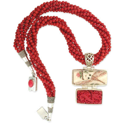 a hinged two-part pendant of carved bone with a stylized dragonfly & flower blossom and a cinnabar rectangle hangs on a 6-string torsade of 4mm red coral beads. bezel-set red coral clasp.