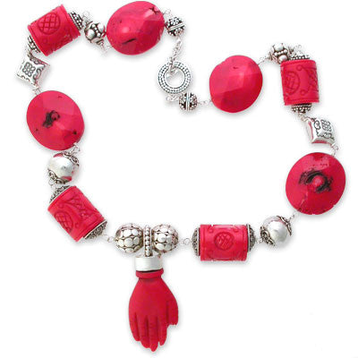 "necklace of large faceted red coral beads, large carved red coral tube beads & assorted large sterling silver beads with a carved red coral 'hand' pendant. pendant drop 2 1/4"". sterling silver toggle clasp."