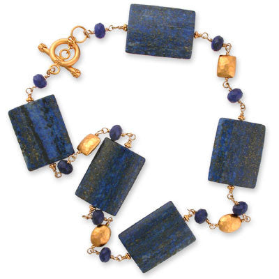 necklace of 24mm x 312mm flat lapis beads interspersed with 8mm faceted lapis rondelles & 22K vermeil hammered oval beads. 22K vermeil toggle clasp.