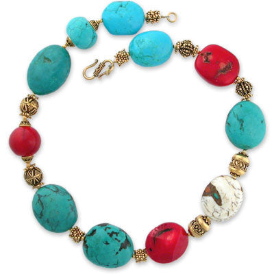 necklace with a variety of extra large turquoise & coral beads and one-offset fossilized nautilus shell bead. vermeil toggle clasp.
