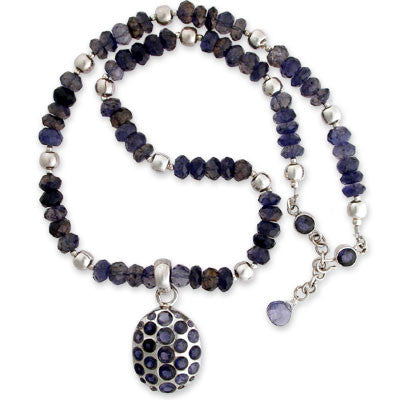 bezel-set pendant of multiple faceted iolites on rough faceted iolite and sterling silver beads. sterling & bezel-set expandable clasp.