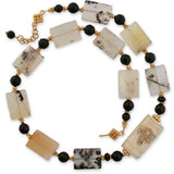 necklace of yellow dendritic opal & black onyx with one offset bone bead with carved dragonlfly. 18 3/4