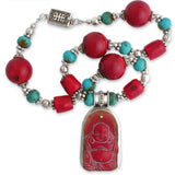 bezel-set red coral laughing buddha pendant on large red coral beads & tubes, interspersed with sterling silver & turquoise rondelles. sterling clasp.
