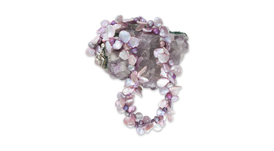 two of the season's hottest colors join together for a spectacular result: a twisted two-strand choker of orchid & pink crinkley-edged cornflake pearls interspersed with dark orchid & pale mauve pearls