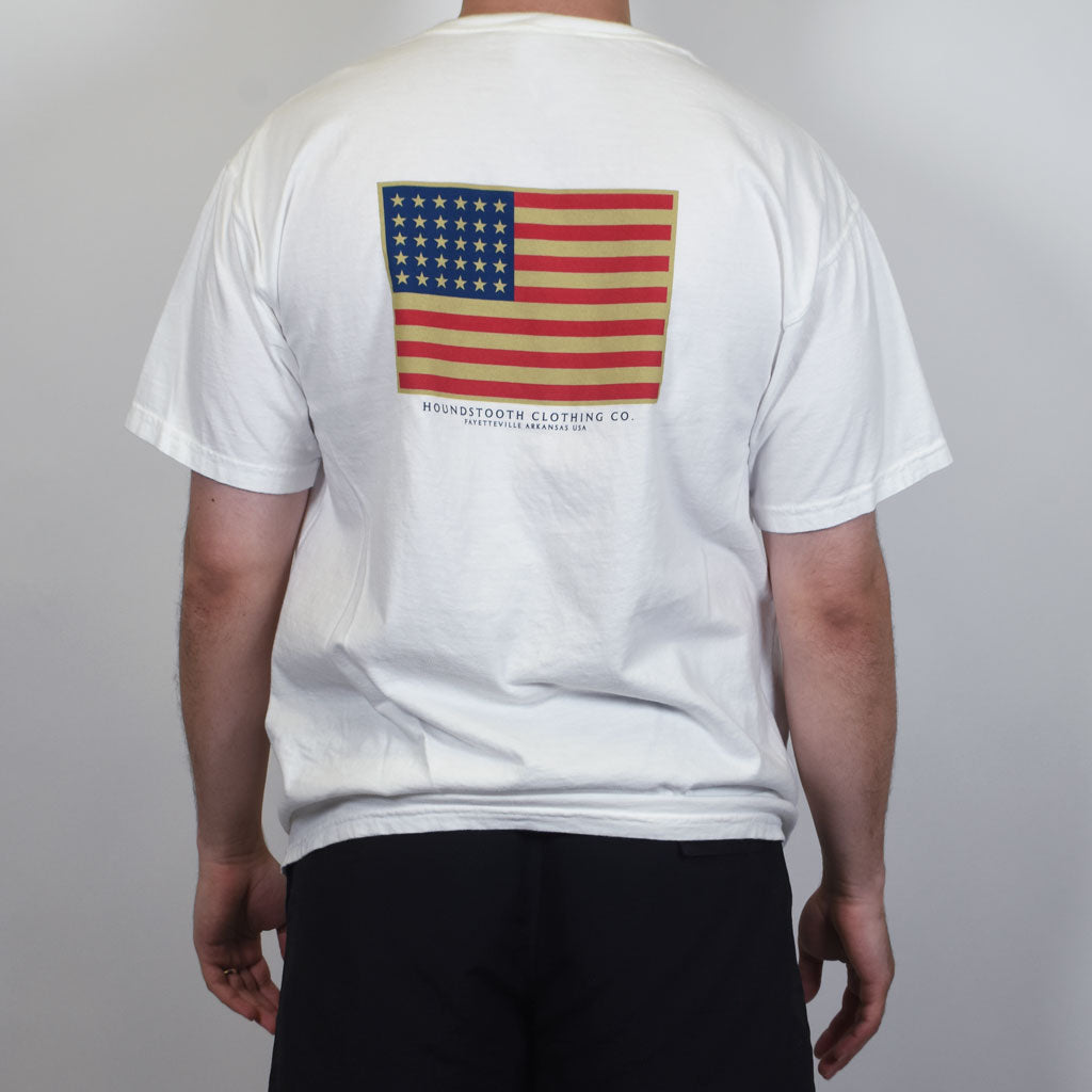 White patriotic t shirt with the American Flag on it made by Houndstooth Clothing Company.