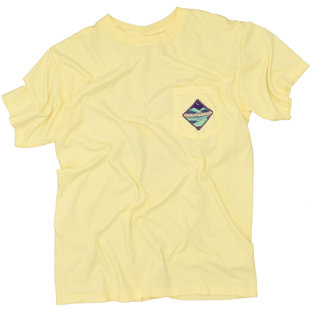 Yellow t shirt with an artful representation of the Ozark Mountains with the test Ozarkansas in the middle.