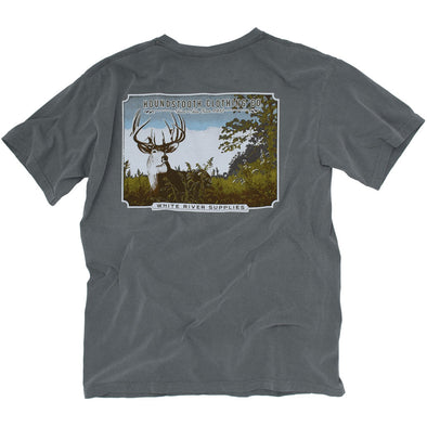 A grey t shirt with a woodcut image of a Buck standing in an Arkansas field.