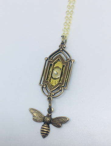 NEW!!  Art Deco Window Pendant with Bee and Bullet Slice - Brass