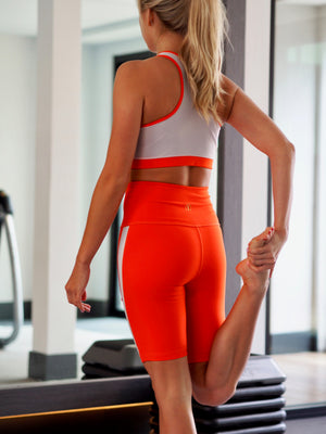 Shama Jade Equinox Biker Short: Neon Orange with White