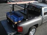 Pickup truck carrying a surf board and cargo at the same time