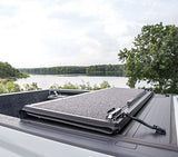 Folding panels attach securely on tonneau cover