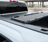 Attractive carpet-like finish on inside of panels of tonneau cover