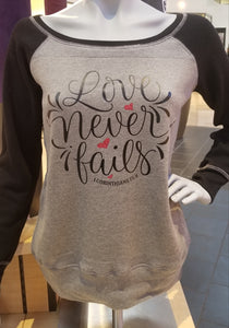 Love Never Fails Long Sleeve (Wide Neck) Sweatshirt
