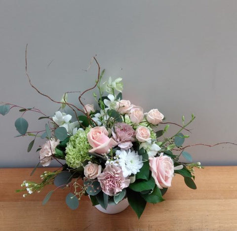 Beautiful pastel design with roses, hydrangea and orchids  in peach and white