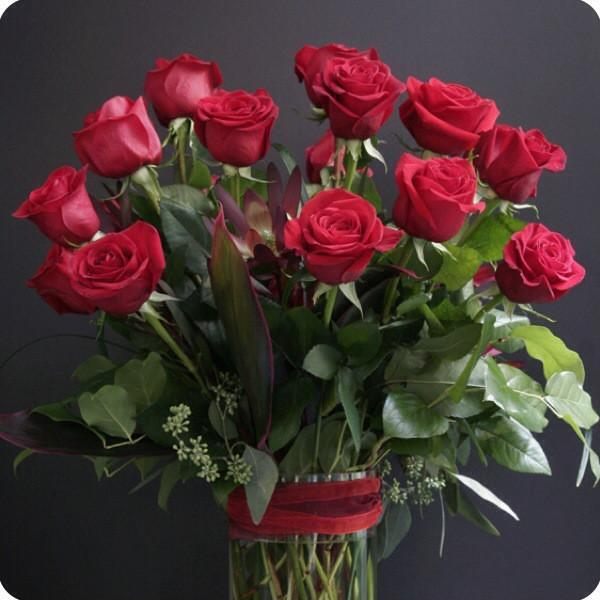 18 Red roses arranged in a vase