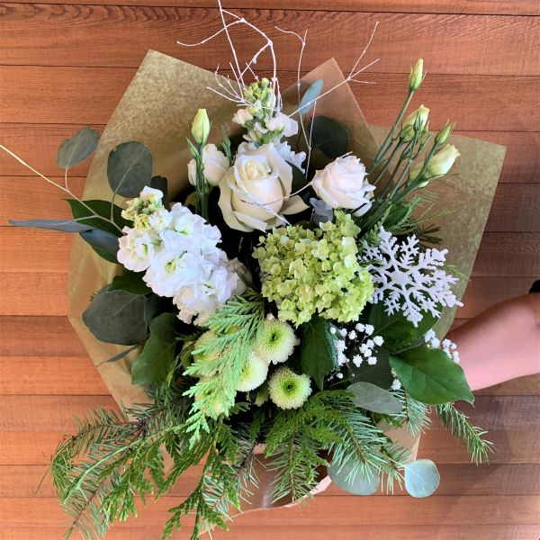white and green flowers with evergreen and eucalyptus.