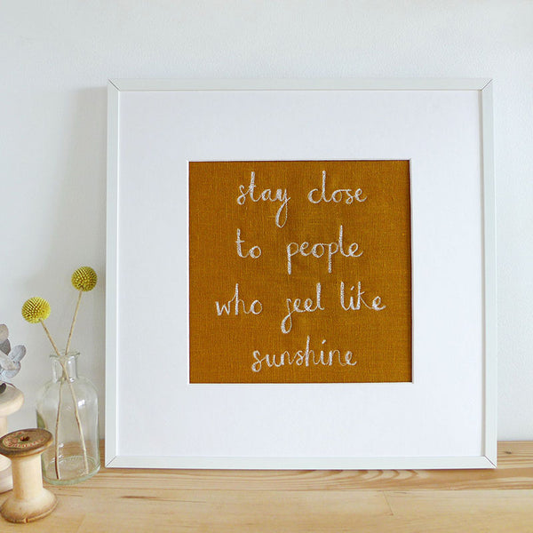 'Stay Close to People Who Feel Like Sunshine' Embroidered Linen Picture